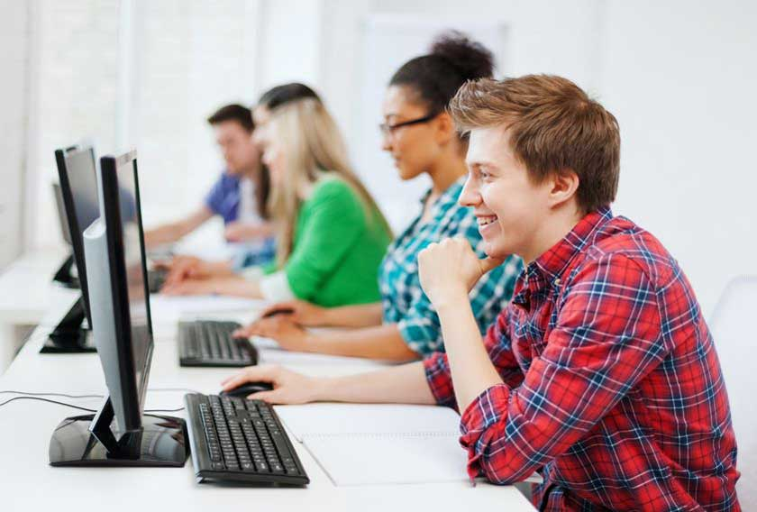 education concept - student with computer studying - copyright:  dolgachov